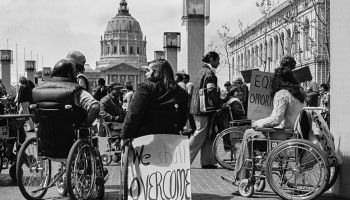 Section 504 protesters demonstrate with signs and placards outside San Francisco's City Hall, April 5, 1977. Photograph by Anthony Tusler.