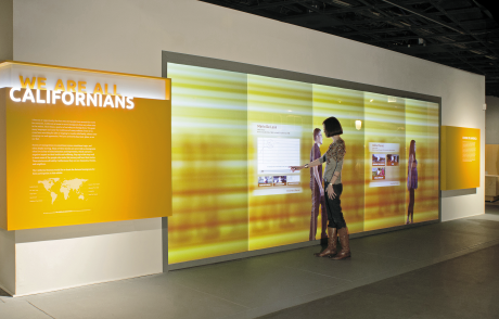 "Interactive multimedia wall in ""We Are All Californians: Stories of Modern Immigration"" at the California Museum. Courtesy of West Office Exhibit Design."