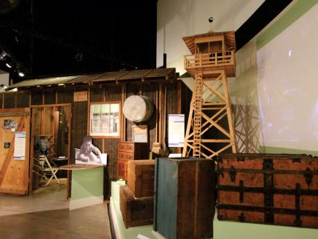 """Uprooted! Japanese Americans During WWII,"" one of the Museum's permanent exhibits, features replica barracks and a watchtower, giving visitors the opportunity to experience life behind barb wire. © 2015 California Museum. All rights reserved."