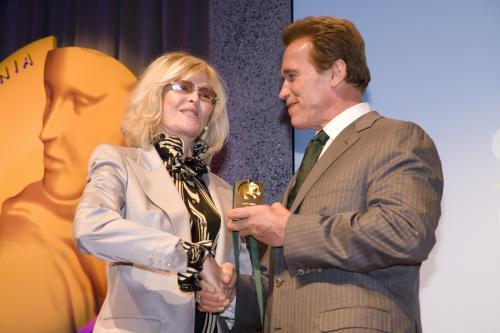 Lorna Berle (wife of Milton Berle) accepts Spirit of California medal from Gov for Milton Berle