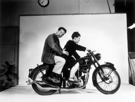 Charles and Ray Eames on a Velocette motorcycle in their studio in Venice, California, 1948. © 2013 Eames Office, LLC (eamesoffice.com).