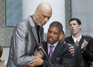 PHOTO: NBA Hall of Famer Kareem Abdul-Jabbar, left, and Sacramento Mayor Kevin Johnson embrace during a news conference outside City Hall in Los Angeles on April 29 after Johnson's comments on the decision by NBA commissioner Adam Silver to ban Los Angeles Clippers owner Donald Sterling from basketball for life. (AP Photo)