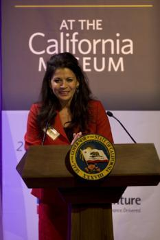 Museum Board Chair Dina Eastwood makes introductory remarks